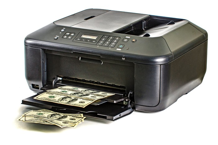 A printer spitting out sheets full of hundred-dollar bills.