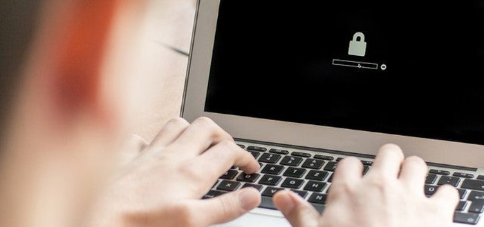 A person logging onto a laptop