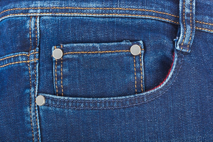 Close-up of a pocket on a pair of blue jeans.