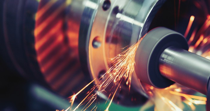 Sparks fly as a high-precision grinding tool is applied to a steel surface.