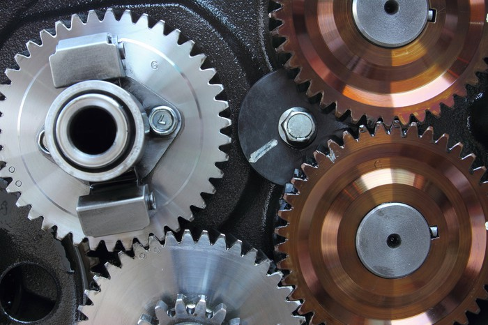 Close-up of steel and copper gears.