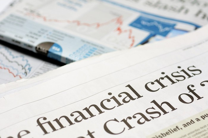 Newspaper headline reads, financial crisis and market crash.