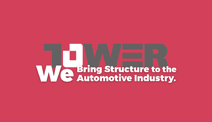 Tower logo and slogan on a red background.