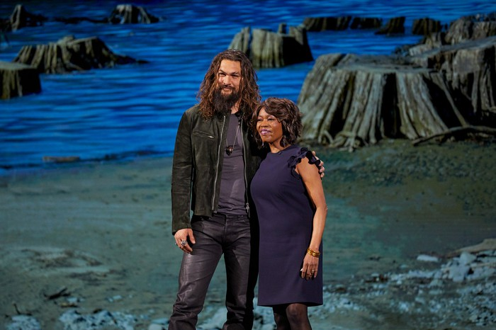 Jason Momoa and Alfre Woodard in front of a scenic backdrop.