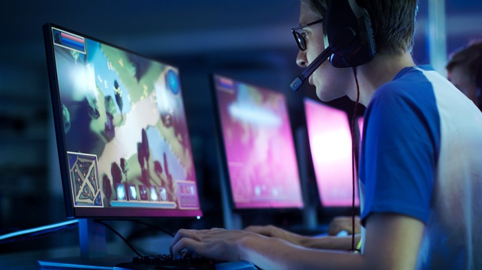 A gamer plays a PC game at an esports tournament.