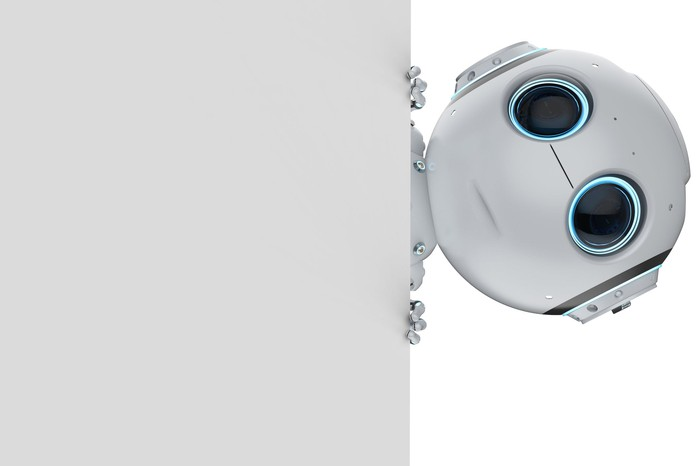 A cute robot peeks around a wall.