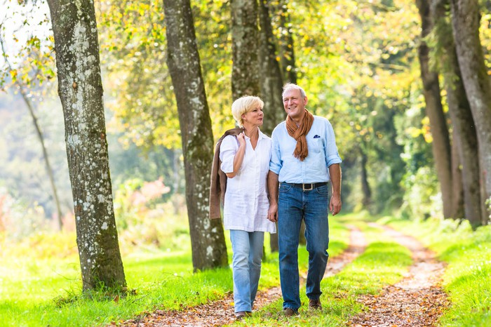 Senior man and woman walking outdoors