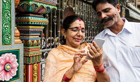 indian couple using phone