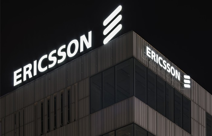 One corner of LM Ericsson's logo-adorned Stockholm headquarters, shot at night.