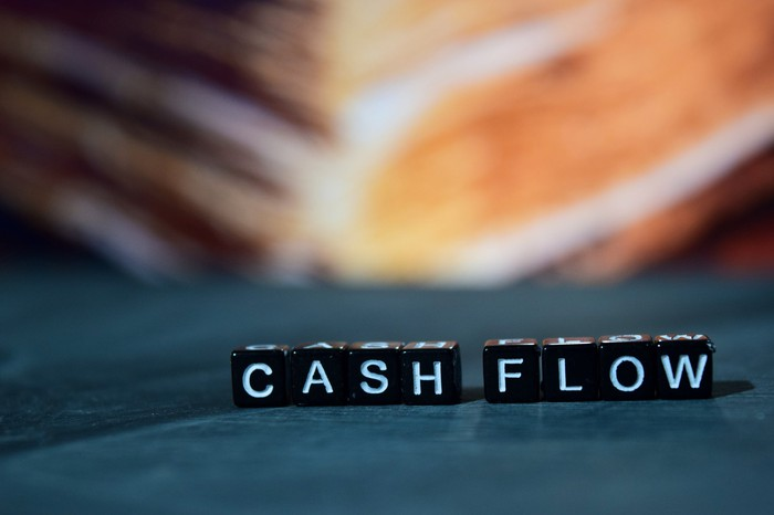 "Blocks spelling out the words ""cash flow."""