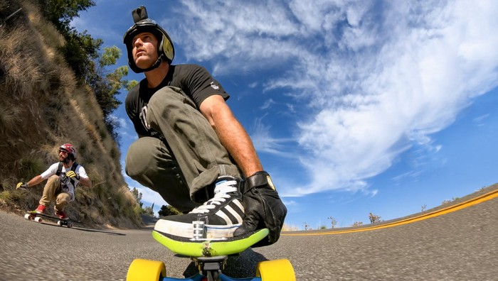 Person skateboarding with a GoPro on his head.