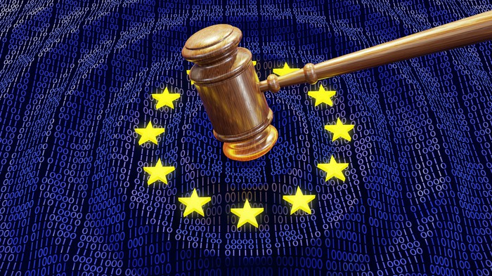 A gavel striking the EU flag with 1s and 0s