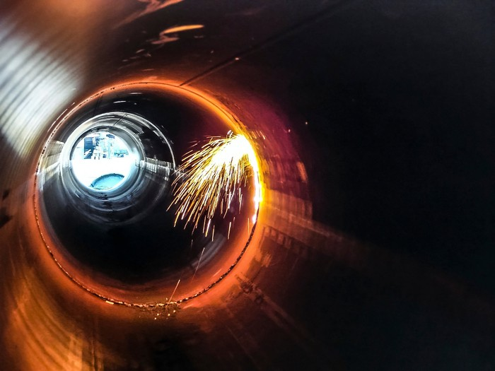 The inside of a pipeline that's being welded together.