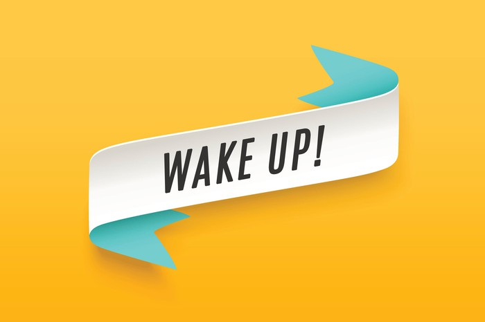 The words wake up are printed on a white strip against a yellow background.
