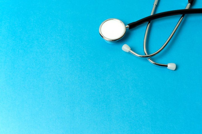 A stethoscope on a blue background.