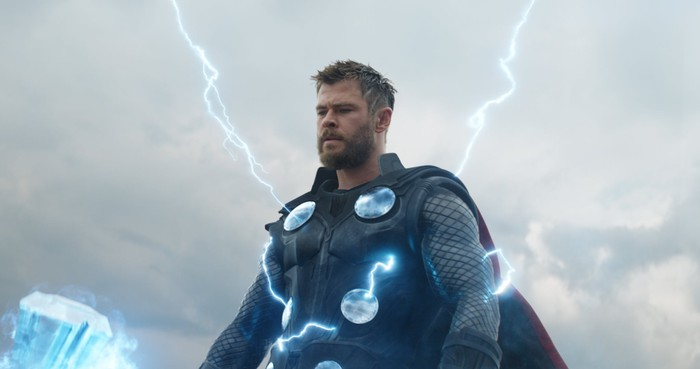 Thor holding his Stormbreaker ax, with lightning emanating from the ax and his body.