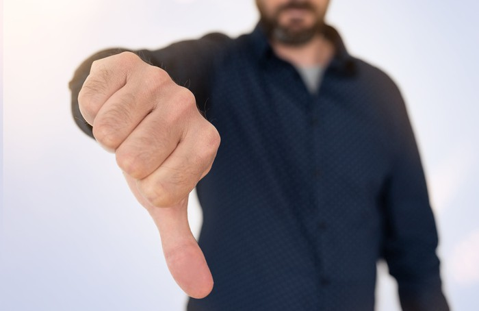 Man with thumb pointed down