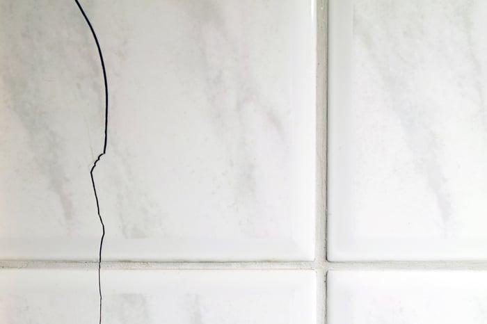 Cracks in a tile floor.