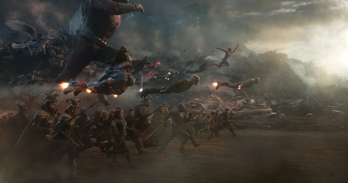 A host of Avengers running and flying into battle against an unseen foe.