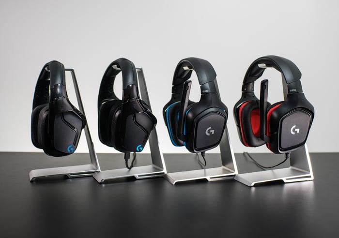 Four Logitech headsets.