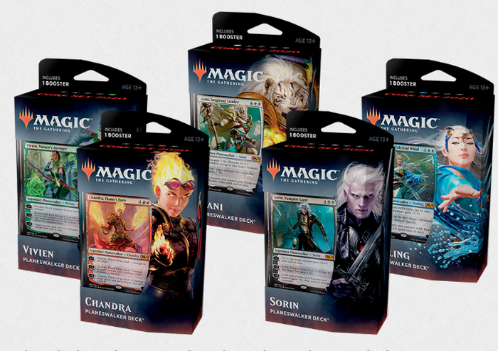 Five packs of Magic card sets.