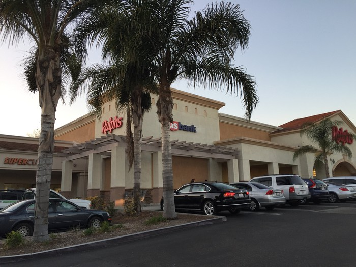 A shopping center with palm trees owned by Retail Opportunity Investments.