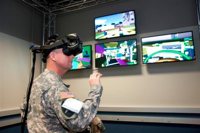 A soldier works with VR goggles.