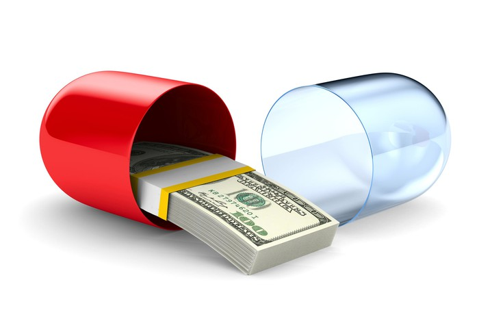 Pill opening with stack of cash in it