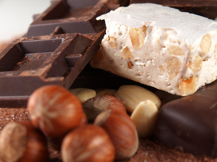 Various types of chocolate next to nuts