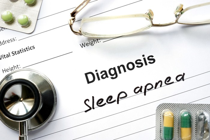 A medical chart reading Diagnosis: Sleep apnea, with a stethoscope