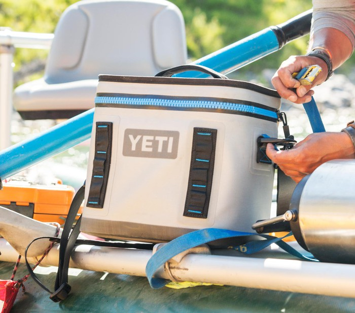 Man strapping in a Yeti cooler