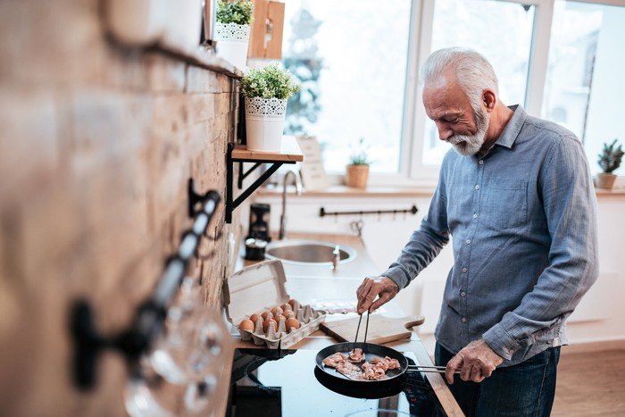 Older man cooking