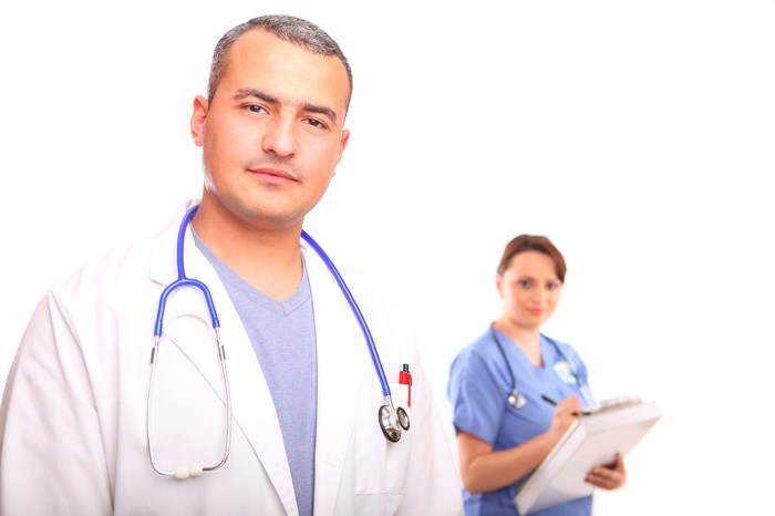 Doctor and nurse looking forward at the viewer