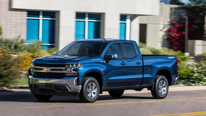"A blue 2019 Chevrolet Silverado pickup in ""crew-cab"" configuration, with four doors and a back seat."