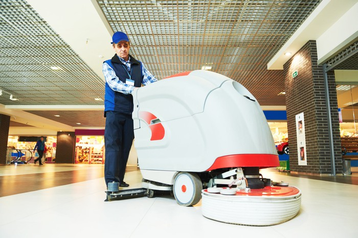 A floor-cleaning machine in action.