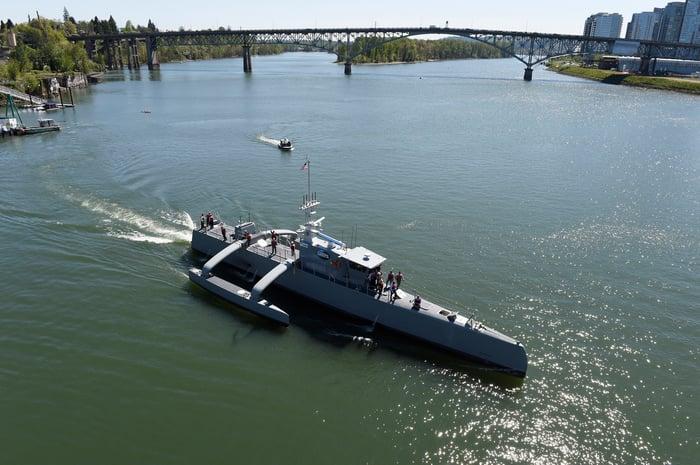 The Sea Hunter autonomous ship makes a turn in a river.