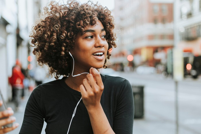 A woman with headphones.