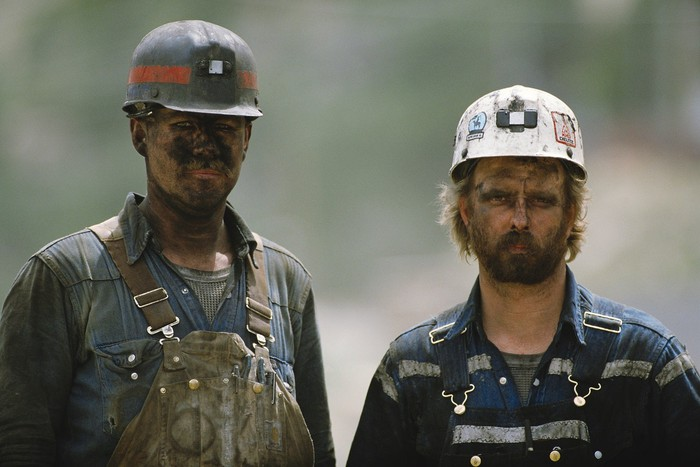 Two coal miners with smudged faces