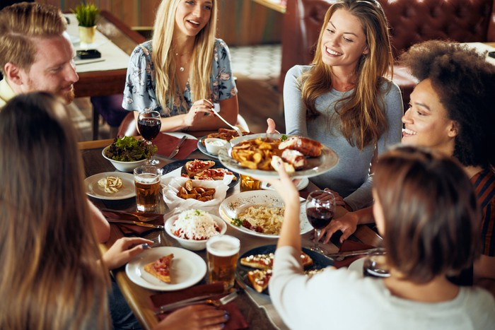 Friends enjoy a meal at a fast-casual restaurant.