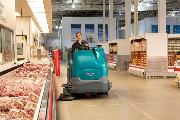 A floor scrubber at work in a grocery store.