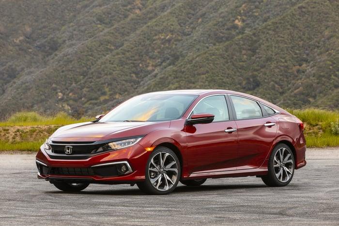A red 2019 Honda Civic, a compact sedan.