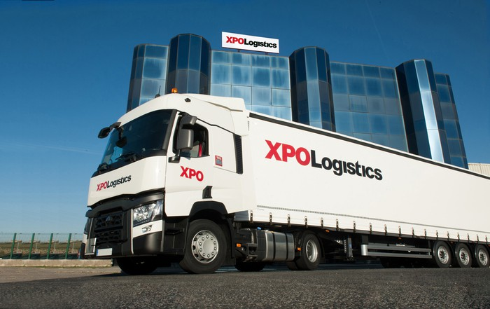 XPO Logistics truck in front of an XPO Logistics building