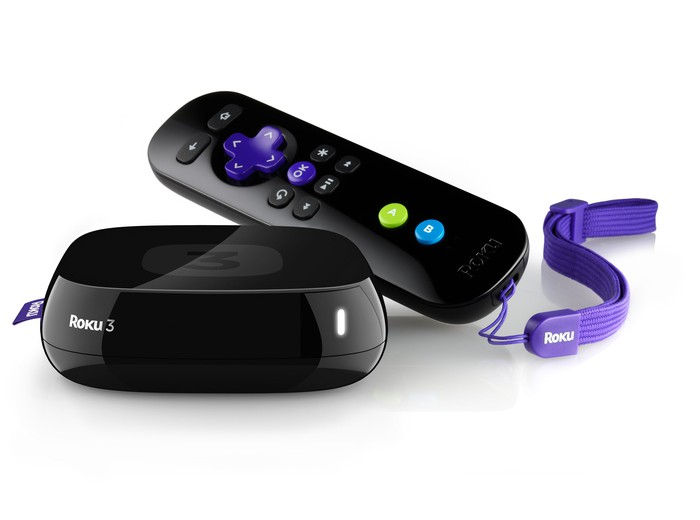 A Roku 3 set-top box and remote control