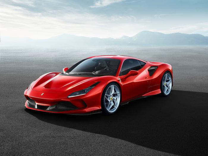 a red Ferrari car sitting on a flat surface