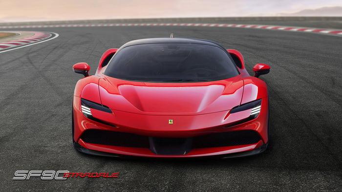 a red Ferrari car on a race track