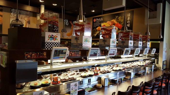 A counter top in a Kura Sushi restaurant