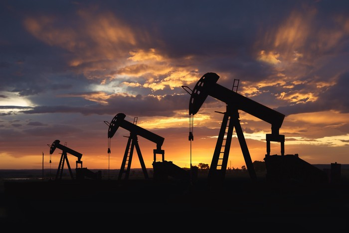 Three oil pumps at sunset