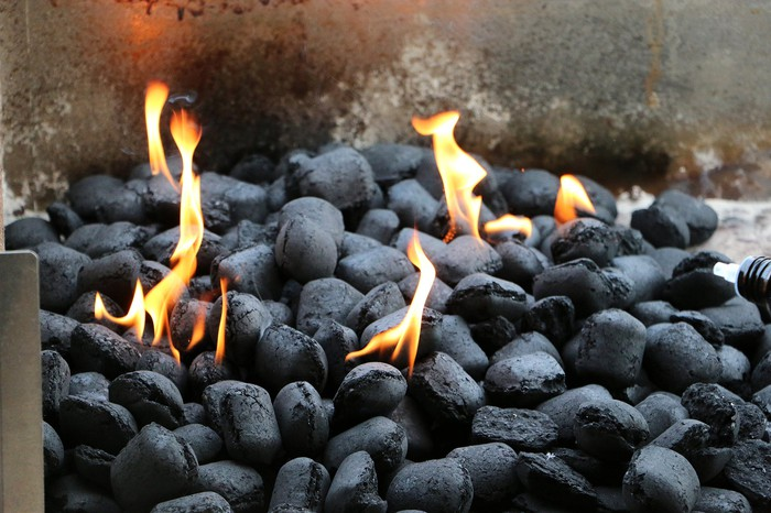 Charcoal burning in an open grill