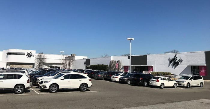 The exterior and parking lot of a Lord & Taylor store.