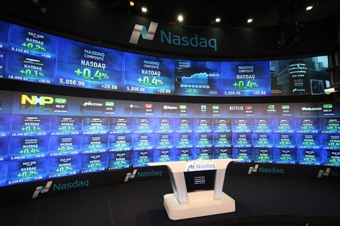 A television studio inside the Nasdaq exchange, with the electronic big board in the background.